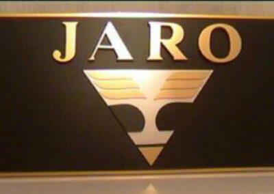 JARO company logo: Unique work, made of plexiglass and comatex.
